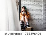 young woman relaxing with music ... | Shutterstock . vector #793596406