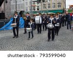 Small photo of Bruges, Belgium - July 21, 2011: A band march in front of world war 2 veterans in Bruges, Belgium