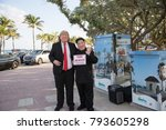 """Small photo of Actors playing Donald Trump and Kim Jong-Un hold """"Fake News"""" poster. Fort Lauderdale Beach, FL, USA. January 13, 2018."""