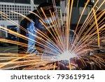 worker is welding automotive... | Shutterstock . vector #793619914