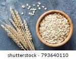 oats in wooden bowl. uncooked...   Shutterstock . vector #793640110