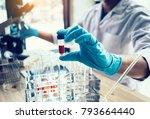 scientist hand holding a test... | Shutterstock . vector #793664440