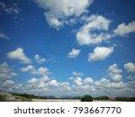 Cumulus Clouds And Blue Sky...