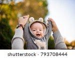 father hands lifting a cute...   Shutterstock . vector #793708444