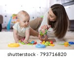 adorable baby boy playing with... | Shutterstock . vector #793716820