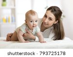 mom and her little son on bed.... | Shutterstock . vector #793725178