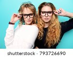 two pretty girls in glasses are ... | Shutterstock . vector #793726690