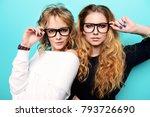 two pretty girls in glasses are ... | Shutterstock . vector #793726690