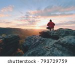 Stock photo hiker standing on top of a mountain and enjoying sunrise beautiful moment the miracle of nature 793729759