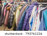 fashion winter coats hanged on... | Shutterstock . vector #793761226