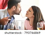 love couple is enjoying pasta... | Shutterstock . vector #793766869