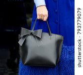 a bag in the hands of a woman | Shutterstock . vector #793779079