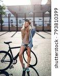 pretty blonde girl in denim... | Shutterstock . vector #793810399