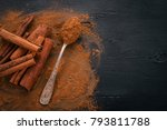 cinnamon on a black wooden... | Shutterstock . vector #793811788