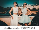 two stylish ladies near classic ... | Shutterstock . vector #793823554