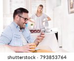 smiling handsome man typing on... | Shutterstock . vector #793853764