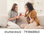 happy girls exchanging gifts.... | Shutterstock . vector #793868863