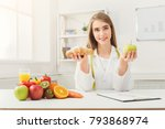 dietitian with bun and fresh... | Shutterstock . vector #793868974