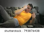 tired sleepy man is laying on... | Shutterstock . vector #793876438