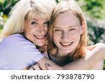 older woman hugging young woman ... | Shutterstock . vector #793878790