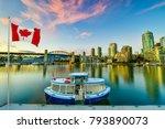 ferry boat docked along in... | Shutterstock . vector #793890073