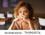 serious woman covering mouth... | Shutterstock . vector #793903576
