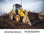 yellow excavator while cleaning ... | Shutterstock . vector #793950499