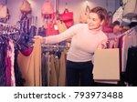 smiling female deciding on... | Shutterstock . vector #793973488
