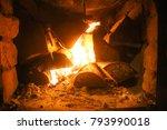 warm light of a burning fire in ...   Shutterstock . vector #793990018