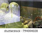 two workers in a protective... | Shutterstock . vector #794004028