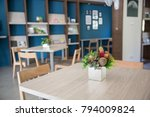 table and chair with blue wall...   Shutterstock . vector #794009824