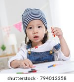 little asian girl drawing on... | Shutterstock . vector #794013358
