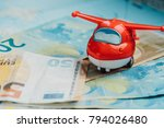 small plastic red plane on euro ... | Shutterstock . vector #794026480