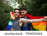 gay couple embracing with... | Shutterstock . vector #794052403