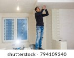 an electrician fixing wires   Shutterstock . vector #794109340