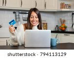 smiling woman using credit card ... | Shutterstock . vector #794113129