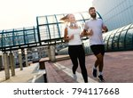 young fitness couple running in ... | Shutterstock . vector #794117668