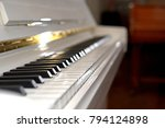 close up of hands playing piano....   Shutterstock . vector #794124898