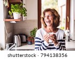 senior woman holding a cup of... | Shutterstock . vector #794138356