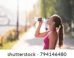 athlete woman drinking water... | Shutterstock . vector #794146480