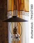 old kerosene lamp at a window   Shutterstock . vector #794147380