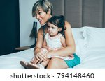 curious mother and daughter... | Shutterstock . vector #794148460