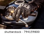 human hand in a motorcycle... | Shutterstock . vector #794159800