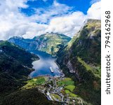 Small photo of Geiranger fjord, Beautiful Nature Norway. It is a 15-kilometre (9.3 mi) long branch off of the Sunnylvsfjorden, which is a branch off of the Storfjorden aerial photography.