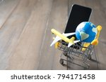 Small photo of earth on shopping card above smart phone, eath image
