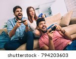 group of friends play video... | Shutterstock . vector #794203603
