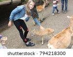 girl with reindeer in the wild... | Shutterstock . vector #794218300