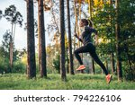 young female athlete jogging in ... | Shutterstock . vector #794226106