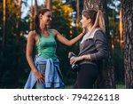 two female runners relaxing... | Shutterstock . vector #794226118