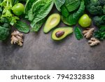 Small photo of Green fruits and leafy vegetables arrangement simbolising vegetarian or healthy alimentary products for keeping detoxifying or getting skinny diet, flat lay template with a space for a text, view from